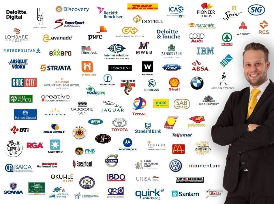 Marcel Oudejans stands by a wall covered by logos of his corporate clients